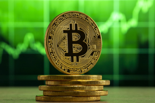 physical bitcoin standing wood table front green graph bitcoin bull market concept 306105 648